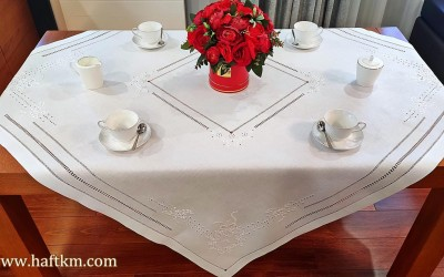 Exclusive hand-embroidered tablecloth.