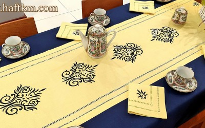 Luxurious, hand-embroidered linen tablecloth.