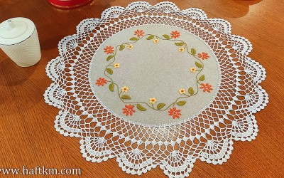 Hand embroidered tablecloth with crochet lace.