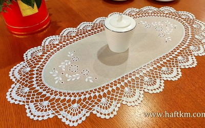 Hand embroidered doily with crochet lace.